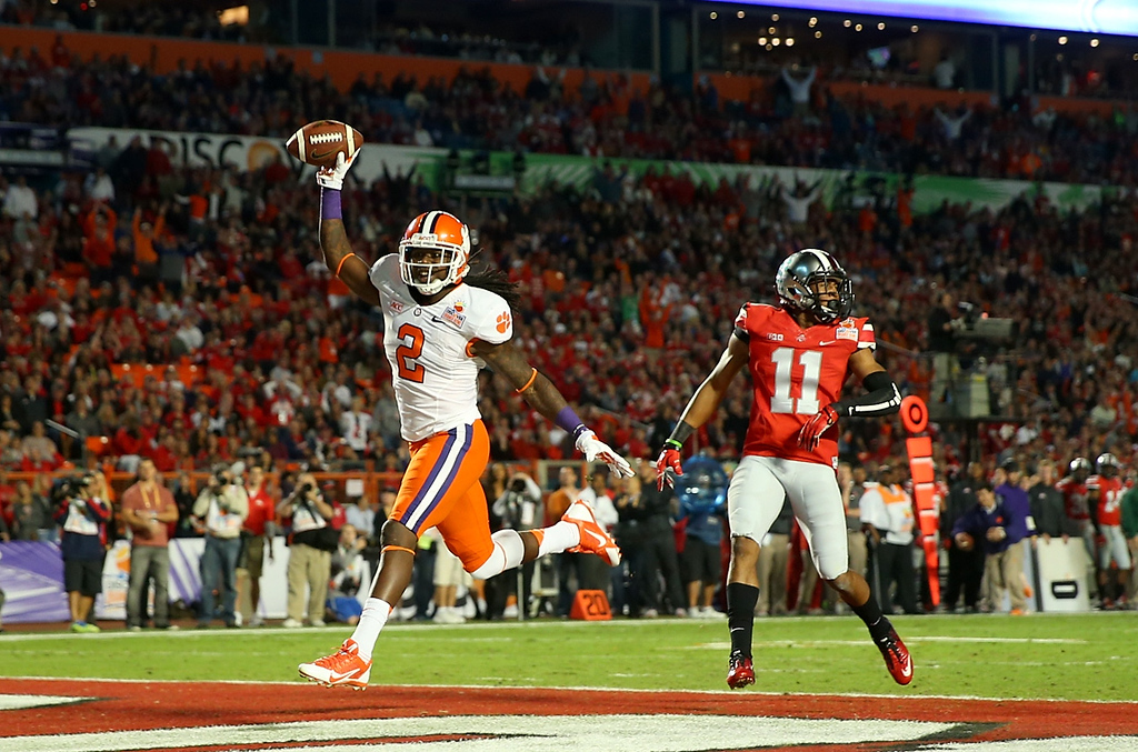 Description of . MIAMI GARDENS, FL - JANUARY 03:  Sammy Watkins #2 of the Clemson Tigers celebrates after scoring a touchdown in the first quarter against Vonn Bell #11 Ohio State Buckeyes during the Discover Orange Bowl at Sun Life Stadium on January 3, 2014 in Miami Gardens, Florida.  (Photo by Mike Ehrmann/Getty Images)