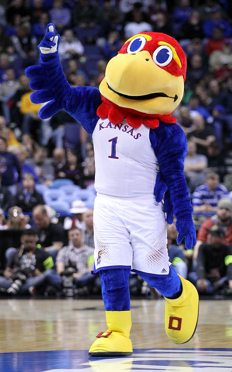 Description of . The Kansas Jayhawks mascot cheers against the Stanford Cardinal during the third round of the 2014 NCAA Men's Basketball Tournament at Scottrade Center on March 23, 2014 in St Louis, Missouri.  (Photo by Andy Lyons/Getty Images)