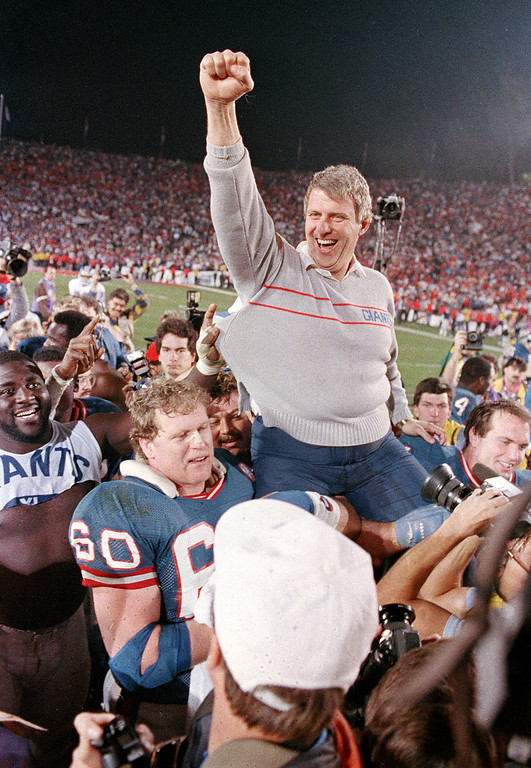 Description of . FILE - In this Jan. 25, 1987, file photo, New York Giants coach Bill Parcells is carried off the field after the Giants defeated the Denver Broncos 39-20 in SuperBowl XXI NFL football game in Pasadena, Calif. Parcells was selected to the Pro Football Hall of Fame on Saturday, Feb. 2, 2013. (AP Photo/Eric Risberg, File)