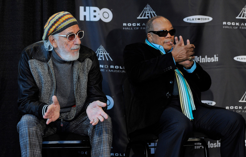 Description of . Rock and Roll Hall of Fame inductees Lou Adler, left, and Quincy Jones applaud as fellow inductees are announced at a news conference, Tuesday, Dec. 11, 2012, in Los Angeles. The 28th Annual Rock and Roll Hall of Fame Induction Ceremony will be held at the Nokia Theatre L.A. Live in Los Angeles on April 18, 2013. (Photo by Chris Pizzello/Invision/AP)