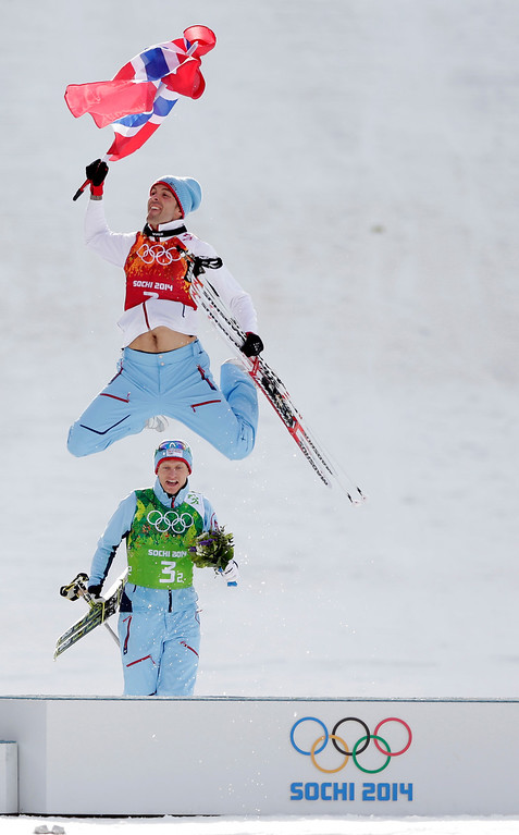 Description of . Norway's Magnus Hovdal Moan, front, and  Haavard Klemetsen celebrate winning the gold after the cross-country portion of the Nordic combined Gundersen large hill team competition at the 2014 Winter Olympics, Thursday, Feb. 20, 2014, in Krasnaya Polyana, Russia. (AP Photo/Matthias Schrader)