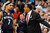 Memphis Grizzlies head coach Lionel Hollins, right, grabs hold of guard Jerryd Bayless during a time out late in the fourth quarter of the Denver Nuggets' 87-80 victory over the Grizzlies in an NBA basketball game in Denver on Friday, March 15, 2013. (AP Photo/David Zalubowski)