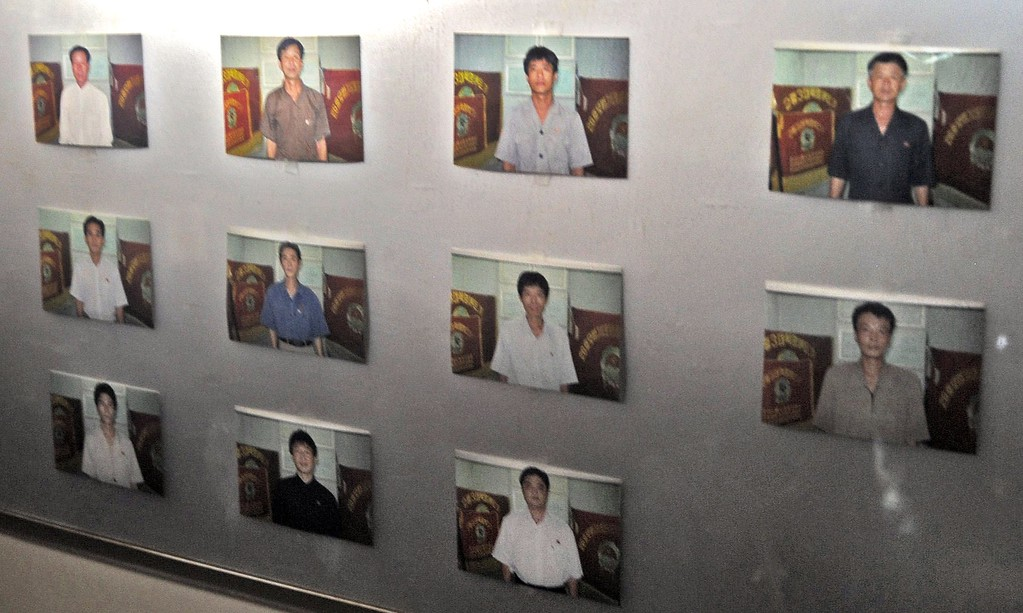 Description of . Portraits of crew members are seen on a wall of North Korean vessel Chong Chong Gang at Manzanillo harbour in Colon, 90 km from Panama City on July 16, 2013.   AFP PHOTO / Rodrigo ARANGUA/AFP/Getty Images
