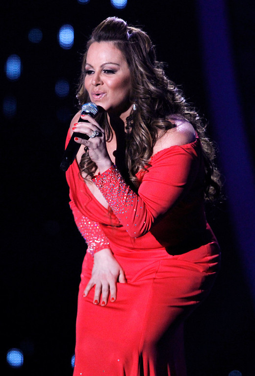 Description of . In this April 26, 2012, file photo, singing superstar Jenni Rivera performs during the Latin Billboard Awards in Coral Gables, Fla. Authorities in Mexico say the wreckage of a small plane believed to be carrying Rivera has been found on Sunday, Dec. 9, 2012, and there are no apparent survivors. (AP Photo/Lynne Sladky, file)