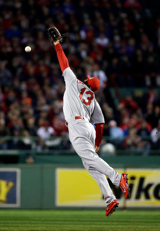 Description of . St. Louis Cardinals' Matt Carpenter cannot make a play on ball hit by  Boston Red Sox's David Ross during the second inning of Game 1 of baseball's World Series Wednesday, Oct. 23, 2013, in Boston. (AP Photo/Matt Slocum)