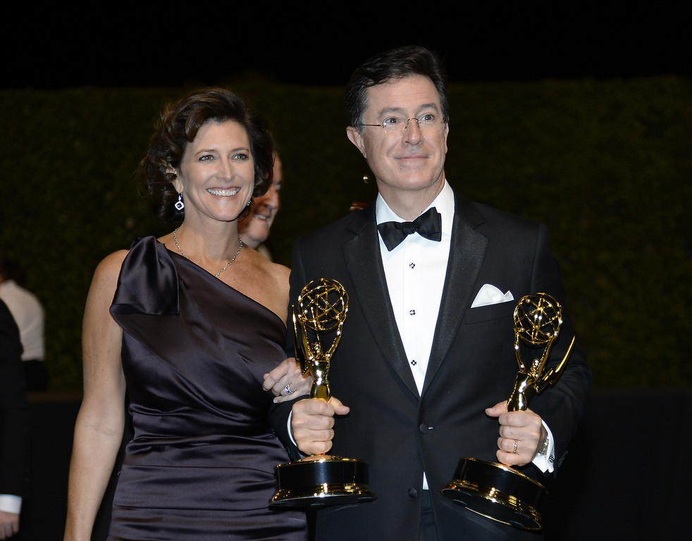 Description of . Actor Stephen Colbert, , winner of the Best Writing for a Variety Series Award and the Variety Series Award for 'The Colbert Report,' and his wife Evelyn Colbert attends the Governors Ball during the 65th Annual Primetime Emmy Awards at Nokia Theatre L.A. Live on September 22, 2013 in Los Angeles, California.  (Photo by Kevork Djansezian/Getty Images)