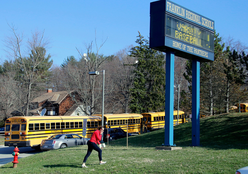 Description of . A woman walks onto the campus of the Franklin Regional School District where several people were stabbed at Franklin Regional High School on Wednesday, April 9, 2014, in Murrysville, Pa., near Pittsburgh. The suspect, a male student, was taken into custody and being questioned. (AP Photo/Gene Puskar)