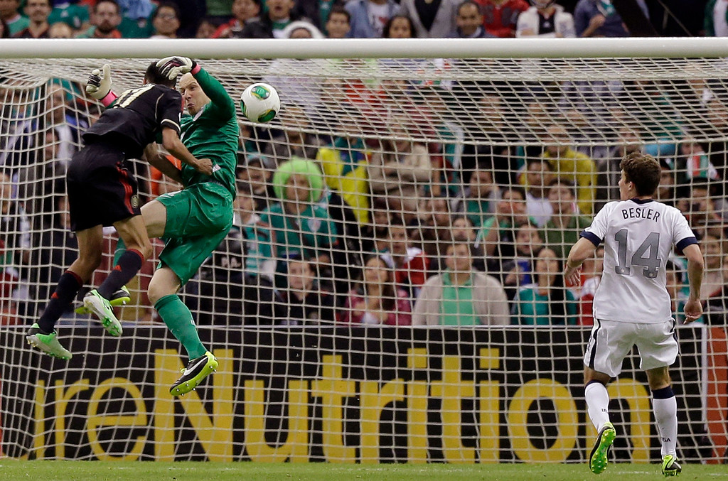 Description of . Mexico's Jesus Zabala, left, collides with United States goalkeeper Brad Guzan, center, while trying to score as United States' Matt Besler looks on during a 2014 World Cup qualifying match at the Aztec stadium in Mexico City, Tuesday, March 26, 2013. (AP Photo/Eduardo Verdugo)