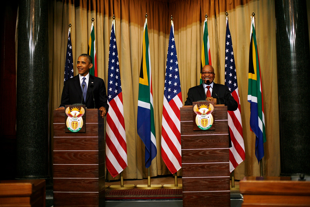 Description of . U.S. President Barack Obama and South African President Jacob Zuma  address a press conference following their meeting at Union Building in Pretoria, South Africa, Saturday June 29, 2013.(AP Photo/Jerome Delay)