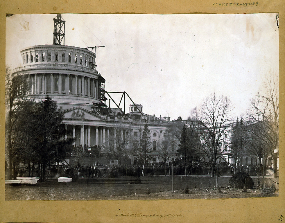 Description of . This photo from 1861 shows the Inauguration of President Abraham Lincoln on the steps of the unfinished Capitol Building in Washington, DC. (Photo from The Library of Congress)