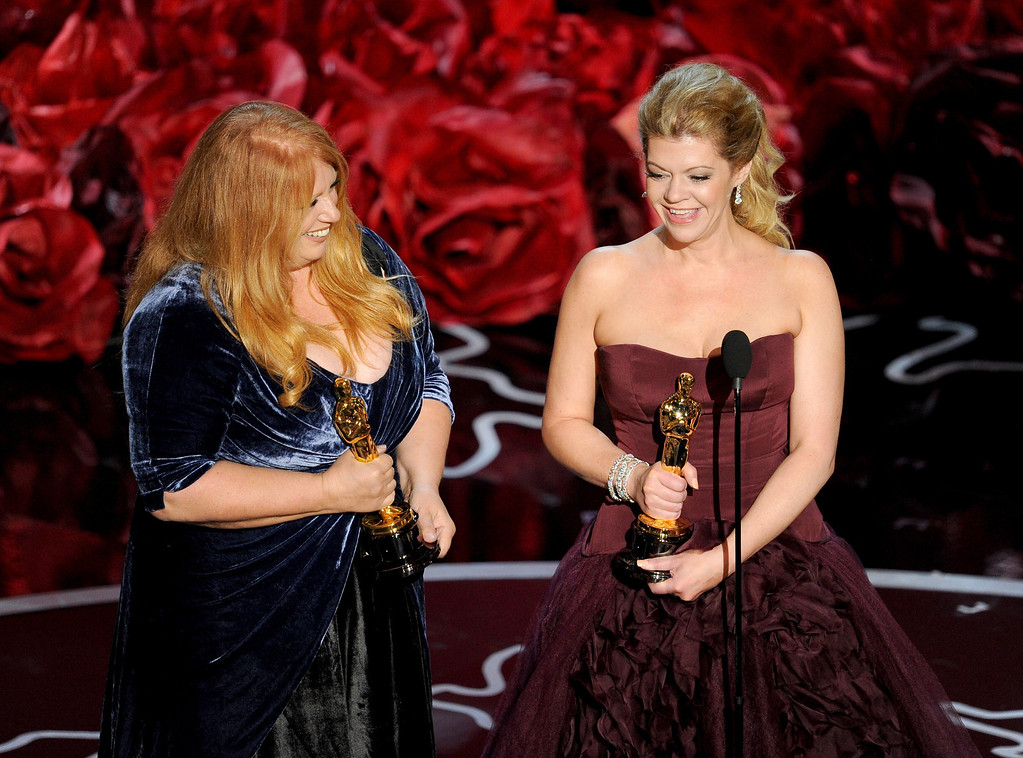 Description of . Adruitha Lee (L) and Robin Mathews accept the Best Achievement in Makeup and Hairstyling award for 'Dallas Buyers Club' onstage during the Oscars at the Dolby Theatre on March 2, 2014 in Hollywood, California.  (Photo by Kevin Winter/Getty Images)