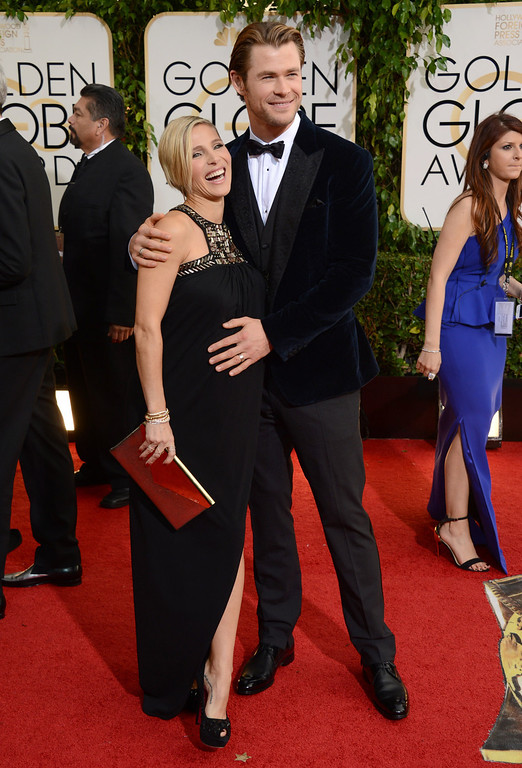 Description of . Elsa Pataky, left, and Chris Hemsworth arrive at the 71st annual Golden Globe Awards at the Beverly Hilton Hotel on Sunday, Jan. 12, 2014, in Beverly Hills, Calif. (Photo by Jordan Strauss/Invision/AP)