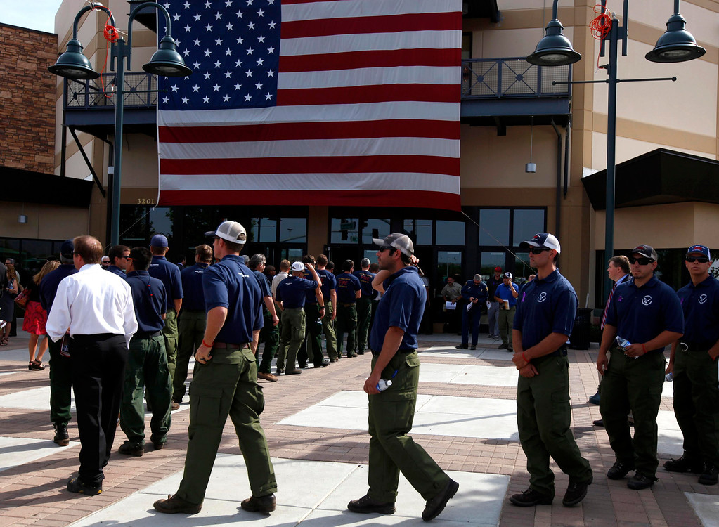 Description of . Firefighters arrive at a memorial for the Prescott Fire Department's Granite Mountain Hotshots team in Prescott Valley, Arizona July 9, 2013.  REUTERS/Mike Blake