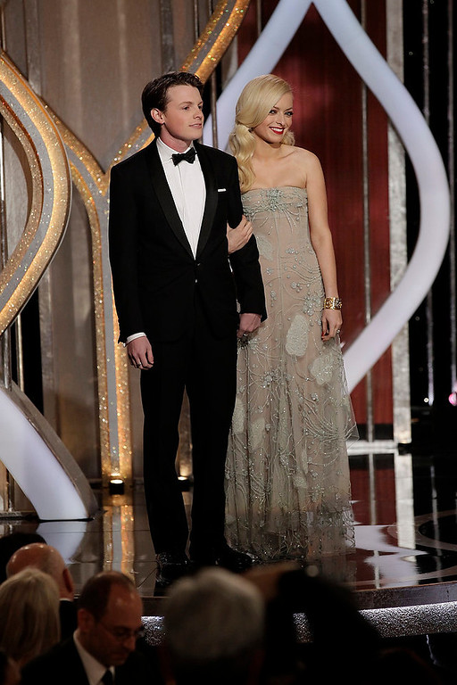 Description of . Sam Fox (L), Mister Golden Globes 2013, and Francesca Eastwood, Miss Golden Globe 2013 on stage at the 70th annual Golden Globe Awards in Beverly Hills, California January 13, 2013, in this picture provided by NBC. REUTERS/Paul Drinkwater/NBC/Handout