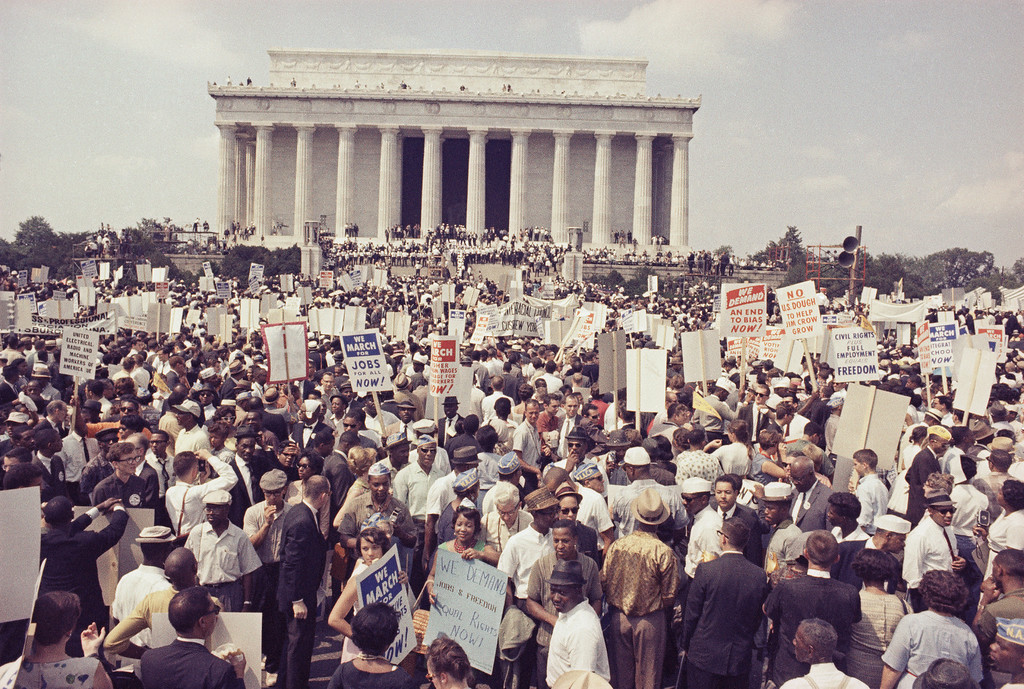 Description of . Large crowds gather at the Lincoln Memorial to demonstrate for civil rights in Washington, Aug. 28, 1963.  (AP Photo)