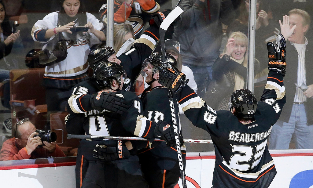 Description of . Anaheim Ducks right wing Corey Perry (10) celebrates his winning goal with teammates including Cam Fowler (4) and Francois Beauchemin (23) during overtime of an NHL hockey game against the Colorado Avalanche in Anaheim, Calif., Sunday, Feb. 24, 2013. The Ducks won 4-3. (AP Photo/Chris Carlson)