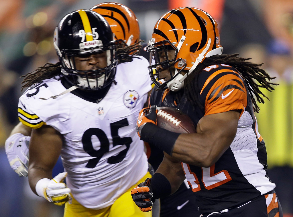 Description of . Cincinnati Bengals running back BenJarvus Green-Ellis (42) runs against Pittsburgh Steelers linebacker Jarvis Jones (95) in the first half of an NFL football game, Monday, Sept. 16, 2013, in Cincinnati. (AP Photo/Al Behrman)