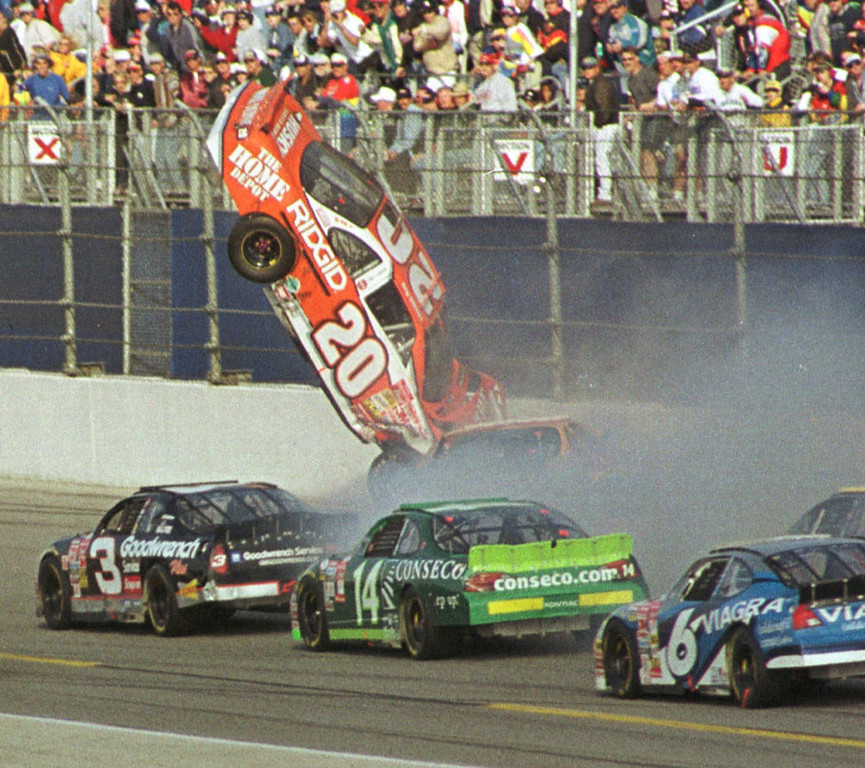 Description of . Tony Stewart (20) flies through the air after an accident during the Daytona 500 Sunday afternoon, Feb. 18, 2001, at the Daytona International Speedway in Daytona Beach, Fla.  Getting by is Dale Earnhardt (3), Ron Hornaday (14) and Mark Martin (6). (AP Photo/Jim Topper)