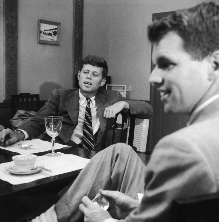 Description of . Sen. Kennedy sits at his home in Georgetown, Mass., with Robert.  Three Lions/Hulton Archive/Getty Images