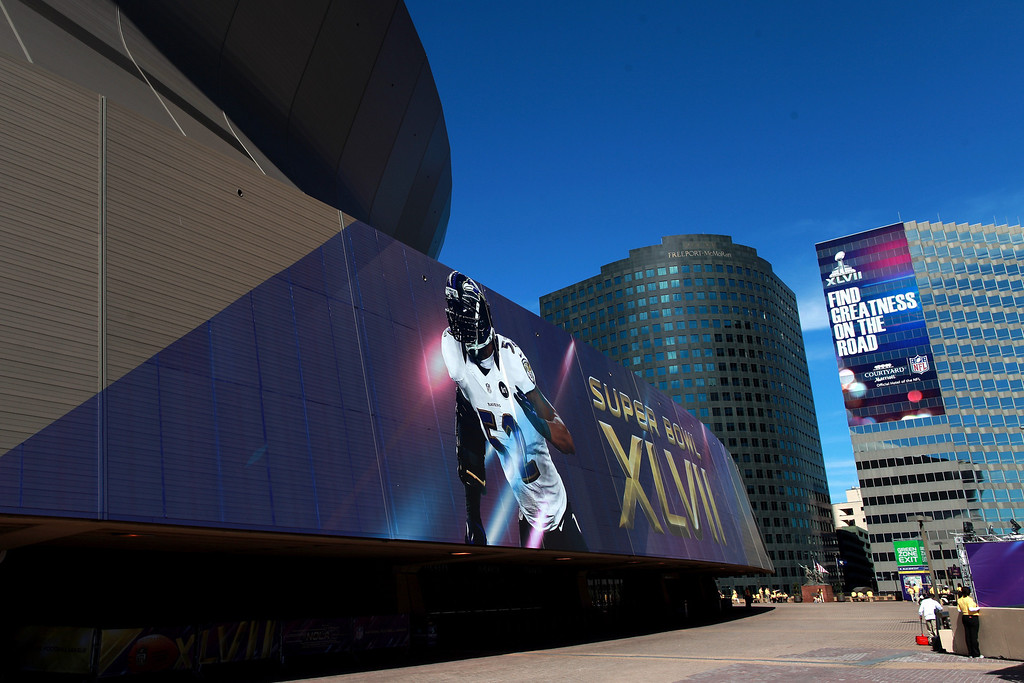 Description of . A large banner on the exterior of the Mercedes-Benz Superdome of Ray Lewis of the Baltimore Ravens is seen before the start of Super Bowl XLVII between the San Francisco 49ers and the Ravens on February 3, 2013 in New Orleans, Louisiana.  (Photo by Rob Carr/Getty Images)