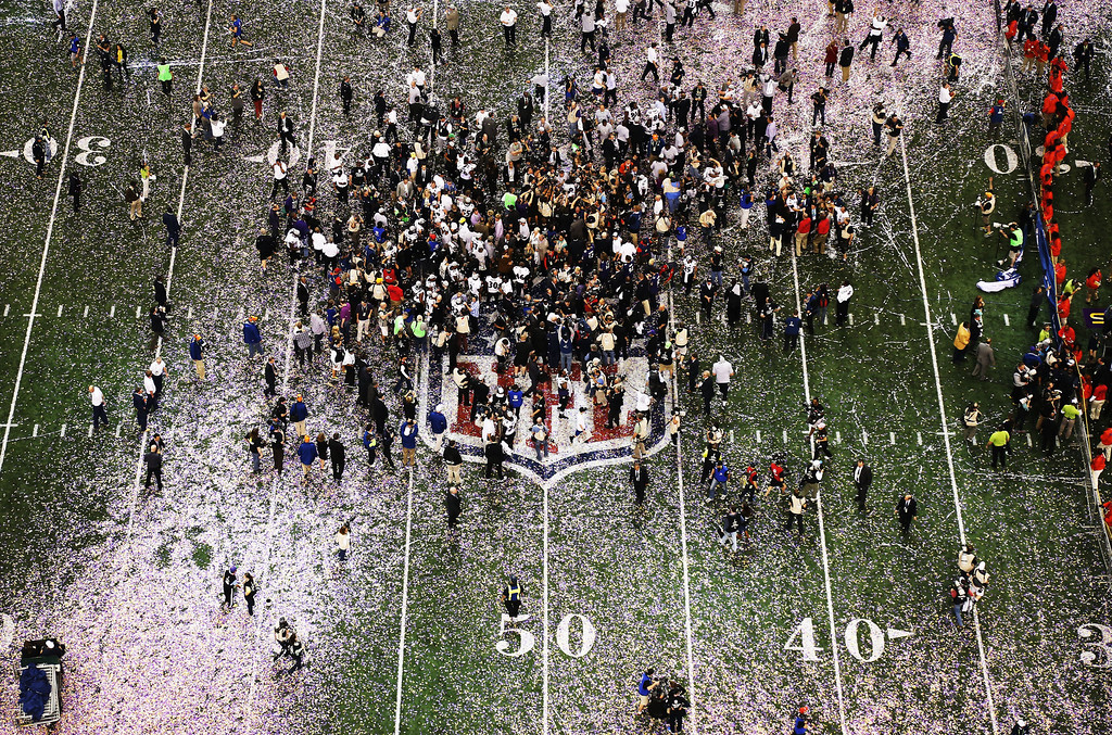 Description of . Confetti falls on the field as the Baltimore Ravens celebrate their 34-31 win against the San Francisco 49ers during Super Bowl XLVII at the Mercedes-Benz Superdome on February 3, 2013 in New Orleans, Louisiana.  (Photo by Chris Graythen/Getty Images)