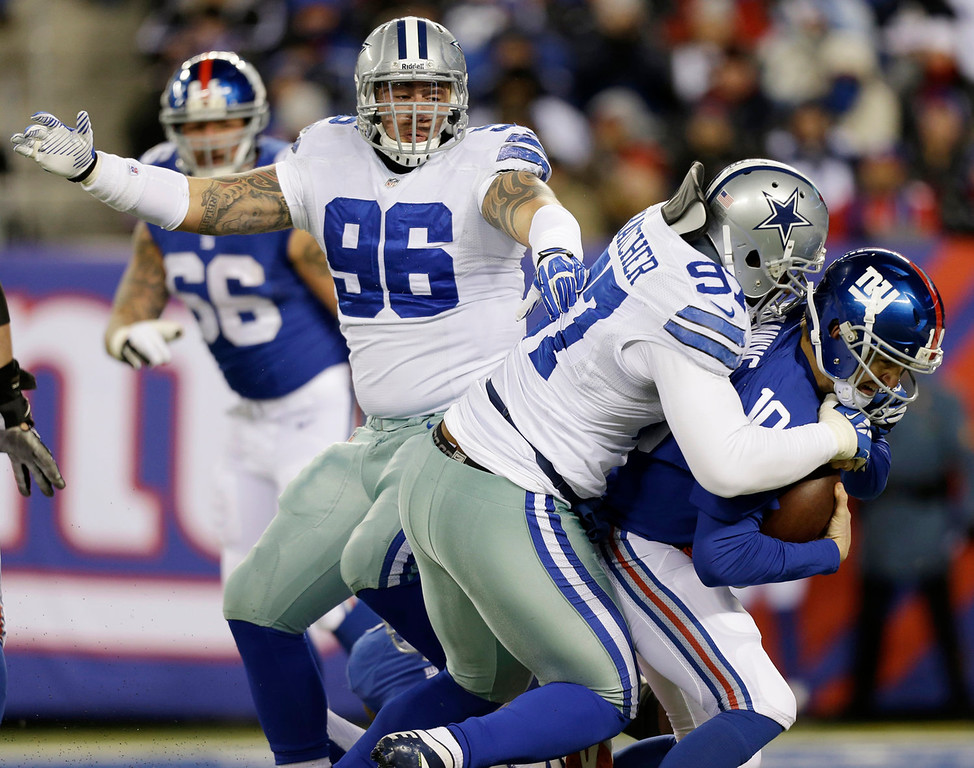 Description of . Dallas Cowboys defensive tackle Jason Hatcher, center, sacks New York Giants quarterback Eli Manning (10) during the first half of an NFL football game Sunday, Nov. 24, 2013, in East Rutherford, N.J. (AP Photo/Frank Franklin II)