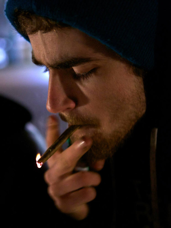 Description of . A Tacoma resident smokes marijuana shortly after a law legalizing the recreational use of  marijuana took effect on December 6, 2012 in Seattle, Washington.  Voters approved an initiative to decriminalize the recreational use of marijuana making it one of the first states to do so. (Photo by Stephen Brashear/Getty Images)