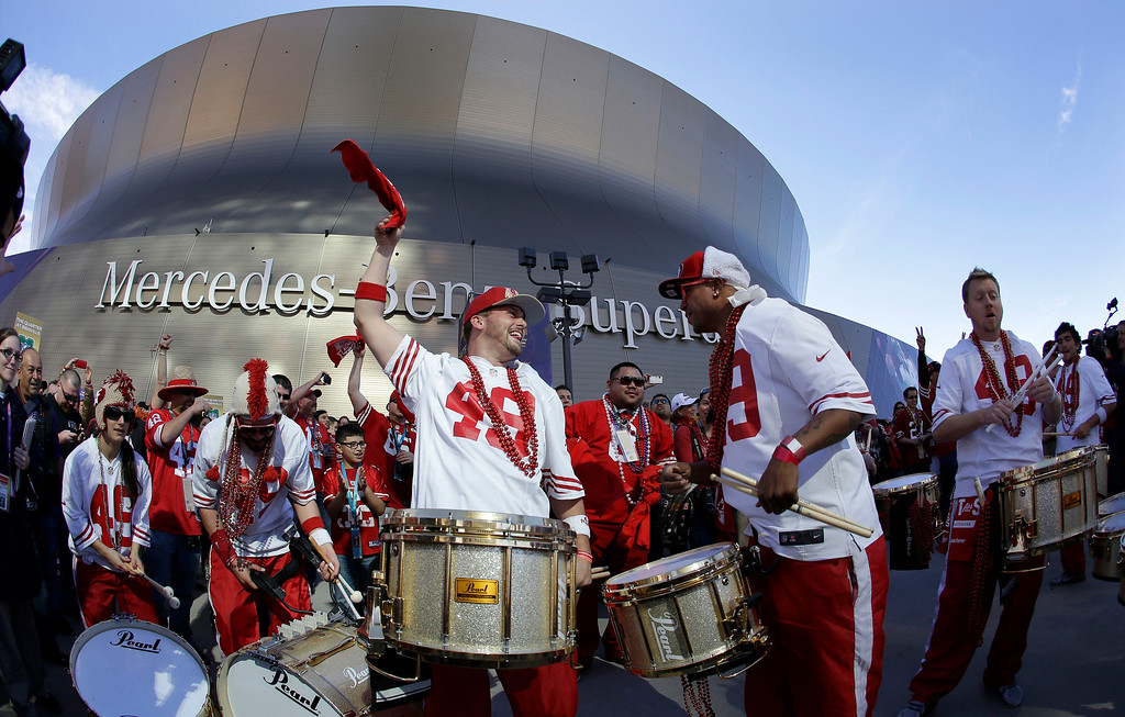 Description of . Members of the Niner Noise Drumline perform outside of the Superdome before the NFL Super Bowl XLVII football game between the San Francisco 49ers and the Baltimore Ravens on Sunday, Feb. 3, 2013, in New Orleans. (AP Photo/Elise Amendola)