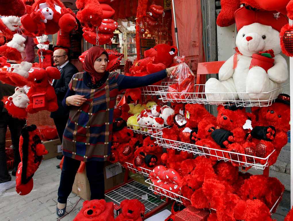 Description of . A woman shops for a Valentine's Day present in central Baghdad, Iraq, Thursday, Feb. 14, 2013. (AP Photo/ Khalid Mohammed)
