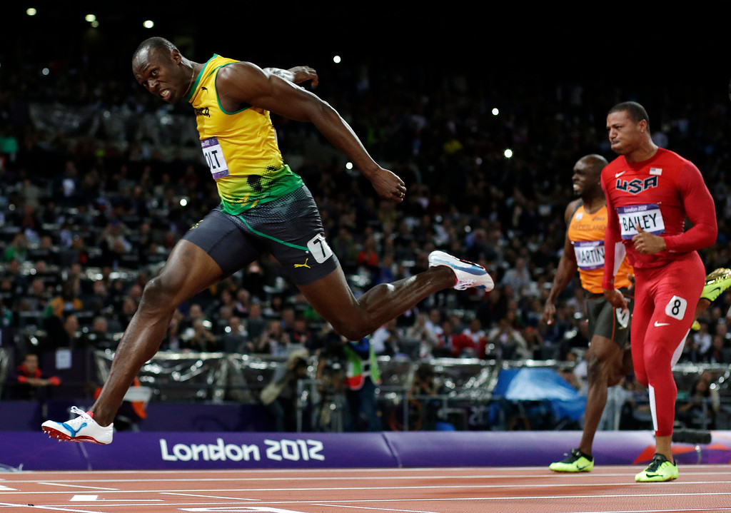 . n this Aug. 5, 2012 file photo, Jamaica\'s Usain Bolt crosses the finish line to win gold in the men\'s 100-meter final during the athletics in the Olympic Stadium at the 2012 Summer Olympics in London. (AP Photo/David J. Phillip, File)