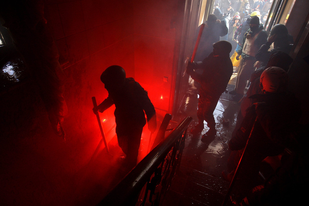 Description of . Protesters take over the main office of the ruling Ukrainian 'Party of Regions' political party in downtown Kiev, Ukraine, 18 February 2014.  EPA/OLEG PETRASYUK