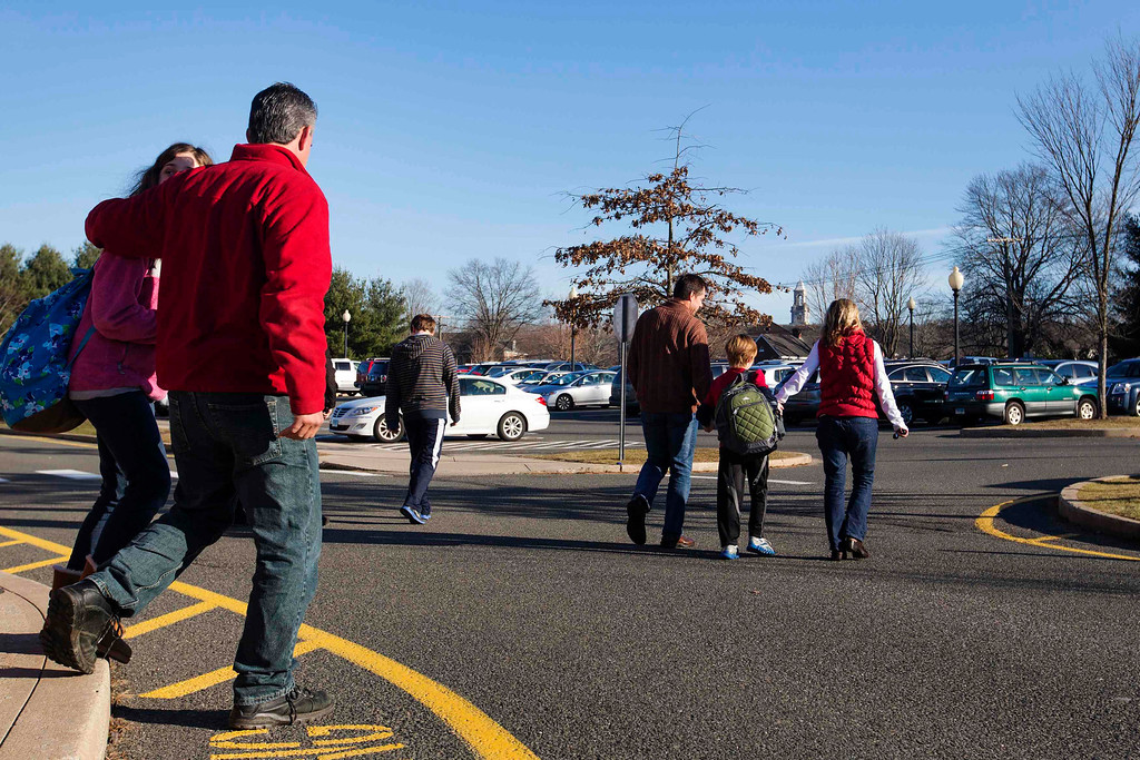 Description of . Families walk to their cars after picking up students from Reed Intermediate School in Newtown, Connecticut, following a shooting nearby at Sandy Hook Elementary School, December 14, 2012. A heavily armed gunman opened fire on school children and staff at a Connecticut elementary school on Friday, killing 26 people including 18 children in the latest in a series of shooting rampages that have tormented the United States this year, U.S. media reported. REUTERS/Lucas Jackson