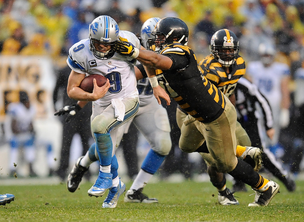 Description of . Matthew Stafford #9 of the Detroit Lions runs for a first down in front of Cameron Heyward #97 of the Pittsburgh Steelers on November 17, 2013 at Heinz Field in Pittsburgh, Pennsylvania. Pittsburgh won the game 37-27.  (Photo by Joe Sargent/Getty Images)