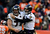 Baltimore Ravens quarterback Joe Flacco (5) celebrates a touchdown pass with Baltimore Ravens center Matt Birk (77) in the second quarter. The Denver Broncos vs Baltimore Ravens AFC Divisional playoff game at Sports Authority Field Saturday January 12, 2013. (Photo by AAron  Ontiveroz,/The Denver Post)