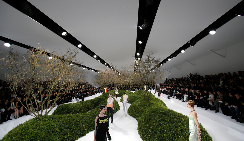 Description of . Models present creations by Raf Simons for Christian Dior's Spring Summer 2013 Haute Couture fashion collection, presented in Paris, Monday, Jan.21, 2013. (AP Photo/Christophe Ena)