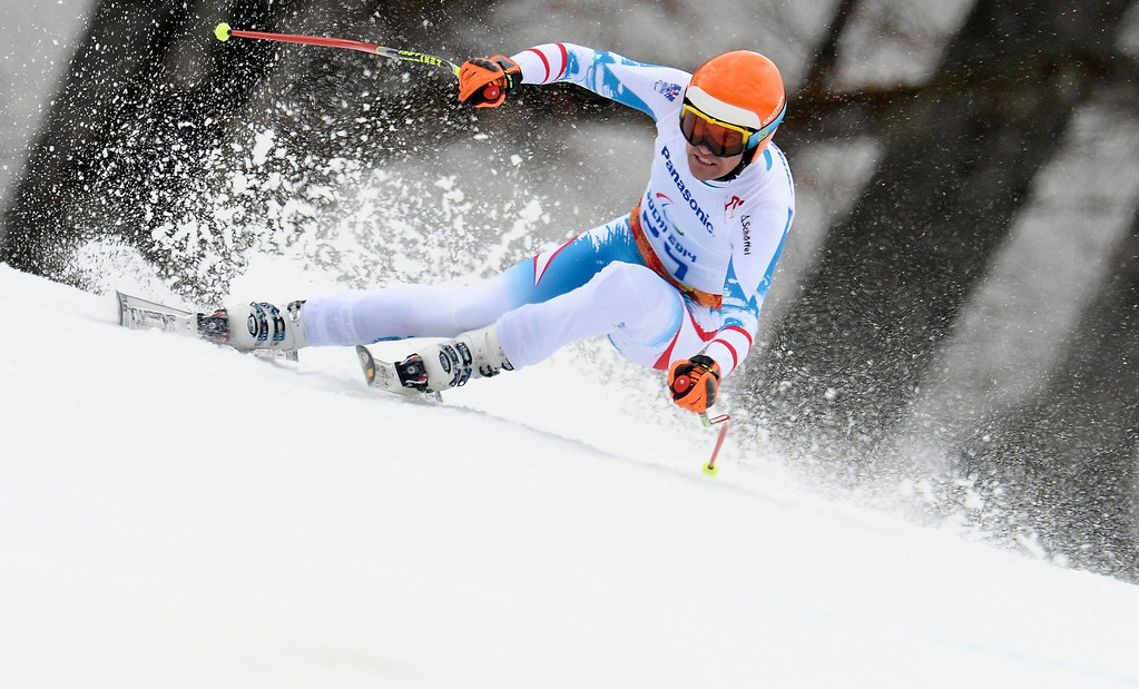 Description of . Matthias Lanzinger of Austria competes in the men's Super-G standing race at the Winter Paralympics 2014 Sochi in Krasnaya Polyana, Russia.  EPA/VASSIL DONEV