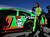 Danica Patrick, driver of the #10 GoDaddy.com Chevrolet, looks on after winning the pole position for the NASCAR Sprint Cup Series Daytona 500 at Daytona International Speedway on February 17, 2013 in Daytona Beach, Florida.  (Photo by Jonathan Ferrey/Getty Images)