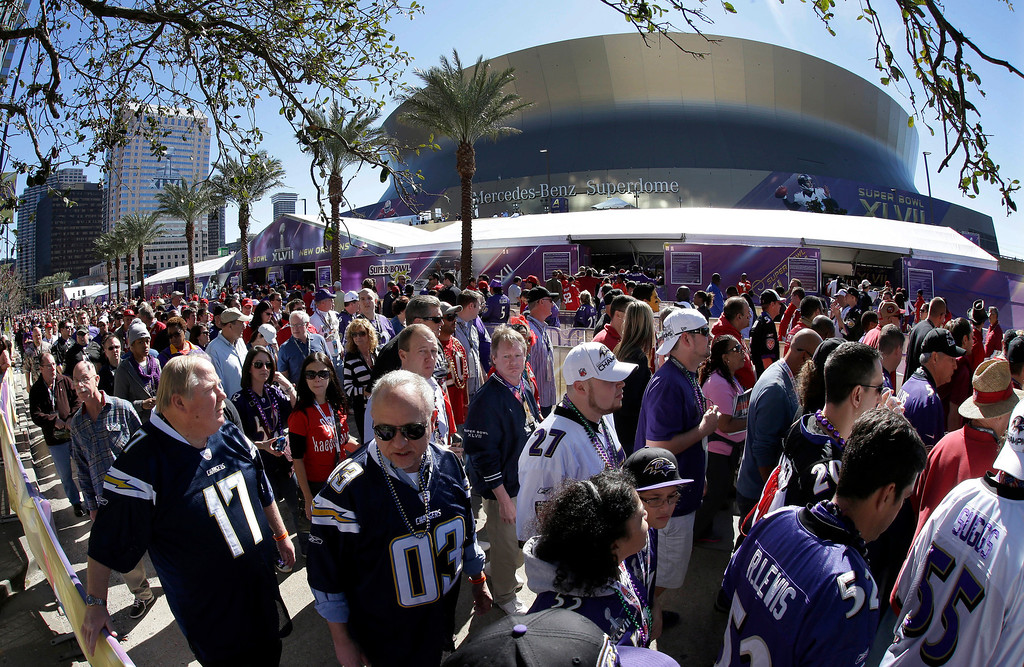 Description of . In this photo made with a fisheye lens, fans line up to enter the Superdome before the NFL Super Bowl XLVII football game between the San Francisco 49ers and the Baltimore Ravens on Sunday, Feb. 3, 2013, in New Orleans. (AP Photo/Gene Puskar)