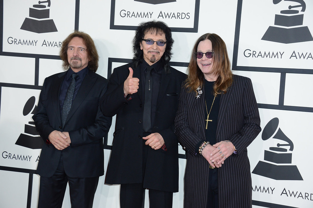 Description of . From left, Geezer Butler, Tony Iommi and Ozzy Osbourne of Black Sabbath arrive at the 56th annual GRAMMY Awards at Staples Center on Sunday, Jan. 26, 2014, in Los Angeles. (Photo by Jordan Strauss/Invision/AP)
