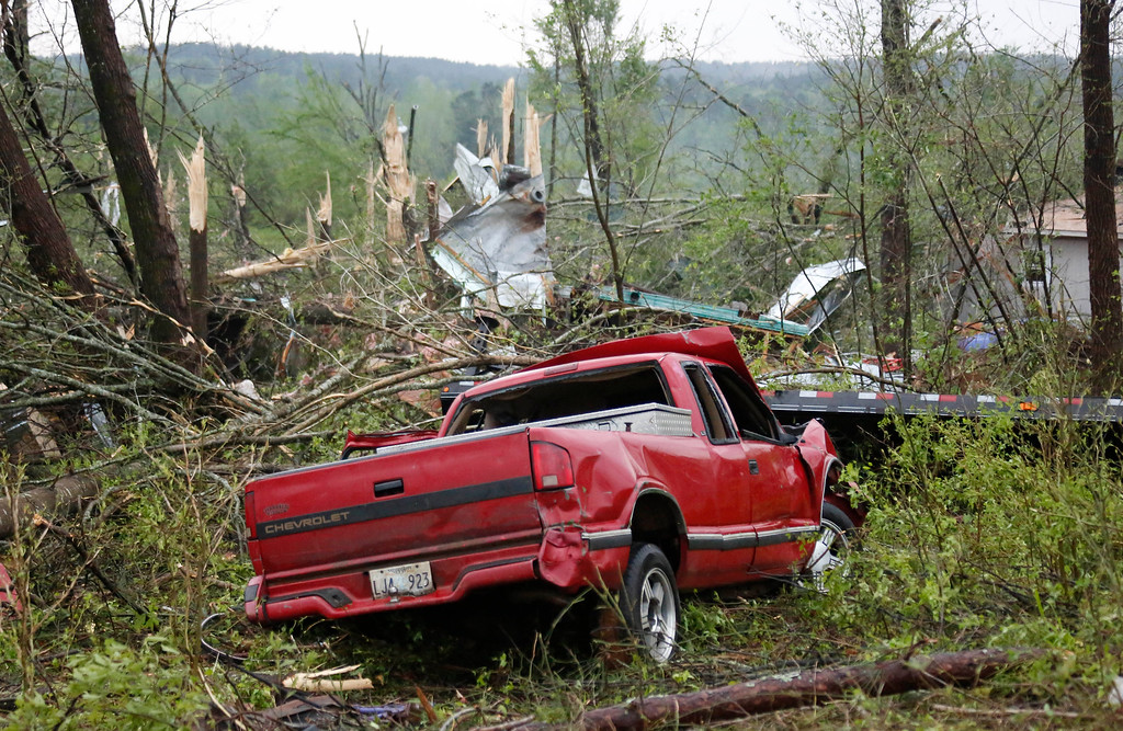 Description of . Torn tree tops and damaged trucks are evidence of the tornado that hit Four Corners, Miss., Monday, April 28, 2014. Tornados flattened homes and businesses, flipped trucks over on highways and injured numerous  people in Mississippi and Alabama on Monday as a massive, dangerous storm system passed over several states in the South, threatening additional twisters as well as severe thunderstorms, damaging hail and flash floods. (AP Photo/Rogelio V. Solis)