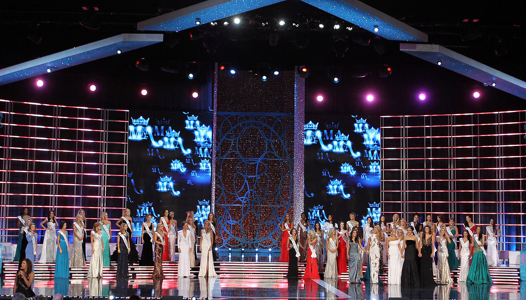 Description of . Contestants compete in the Miss America 2013 pageant on Saturday, Jan. 12, 2013, in Las Vegas. (AP Photo/Isaac Brekken)