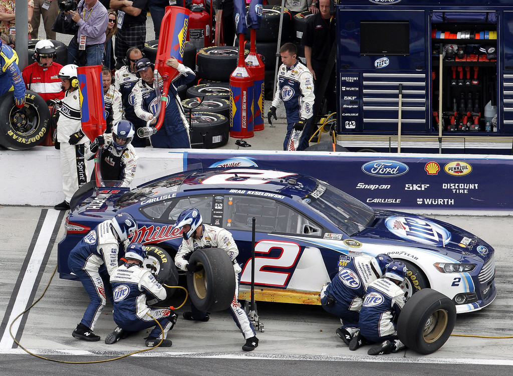 Description of . Brad Keselowski pits for fuel and tires during the NASCAR Daytona 500 Sprint Cup Series auto race at Daytona International Speedway, Sunday, Feb. 24, 2013, in Daytona Beach, Fla. (AP Photo/David Graham)