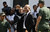 Haiti's President Michel Martelly raises his fist after attending the funeral ceremony for Venezuela's late President Hugo Chavez at the military academy in Caracas, Venezuela, Friday, March 8, 2013.  (AP Photo/Fernando Llano)