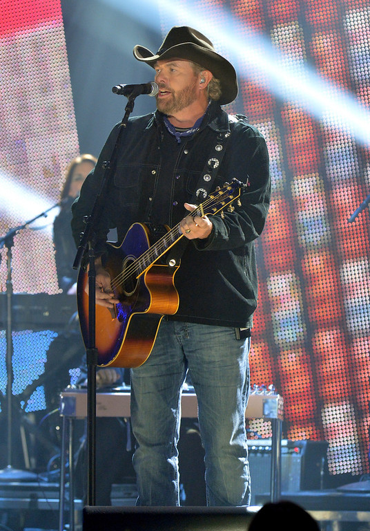 Description of . Toby Keith performs onstage during the 2012 CMT Artists Of The Year at The Factory at Franklin on December 3, 2012 in Franklin, Tennessee.  (Photo by Rick Diamond/Getty Images for CMT)