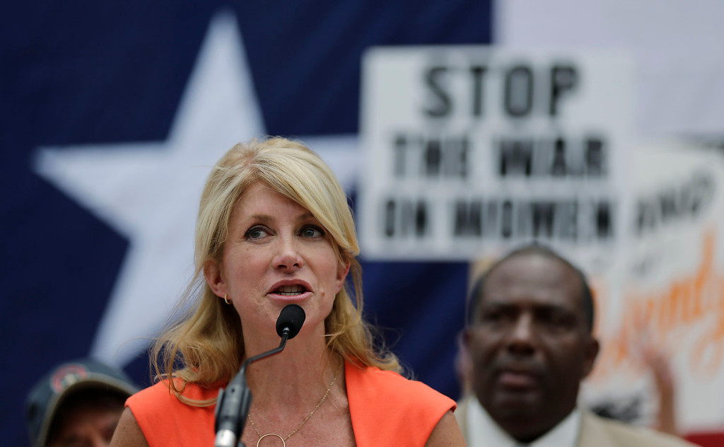 Description of . Sen. Wendy Davis, D- Fort Worth, speaks during a rally against abortion legislation, Monday, July 1, 2013, in Austin, Texas. The Texas Senate has convened for a new 30-day special session to take up a contentious abortion restrictions bill and other issues. (AP Photo/Eric Gay)