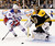 New York Rangers' Derek Stepan (21) skates for the rebound off Boston Bruins goalie Tuukka Rask (40), of Finland, during the first period of an NHL hockey game in Boston, Saturday, Jan. 19, 2013. (AP Photo/Michael Dwyer)