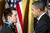 US President Barack Obama thanks US Army Staff Sargent Clinton Romesha during a Medal of Honor ceremony in the East Room of the White House February 11, 2013 in Washington, DC. AFP PHOTO/Brendan  SMIALOWSKI/AFP/Getty Images