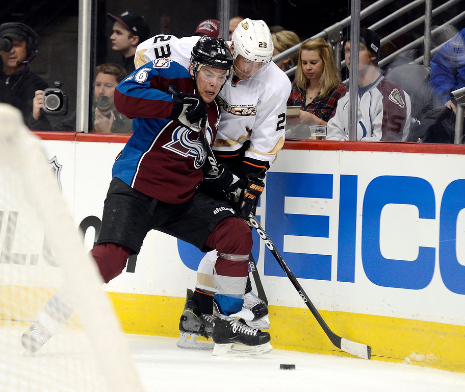 Description of . DENVER, CO. - FEBRUARY 06: Paul Stastny (26) of the Colorado Avalanche pins Francois Beauchemin (23) of the Anaheim Ducks agians the boards during the first period February 6, 2013 at Pepsi Center. The Colorado Avalanche take on the Anaheim Ducks during NHL action. (Photo By John Leyba / The Denver Post)