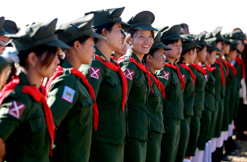 Description of . Nurses in uniforms of the Ta-ang National Liberation Army (TNLA) attend the 51st anniversary of Ta-ang Army Revolution Day in Homain village, Nansam Township, Northern Shan State, Myanmar, 12 January 2014.   EPA/NYEIN CHAN NAING