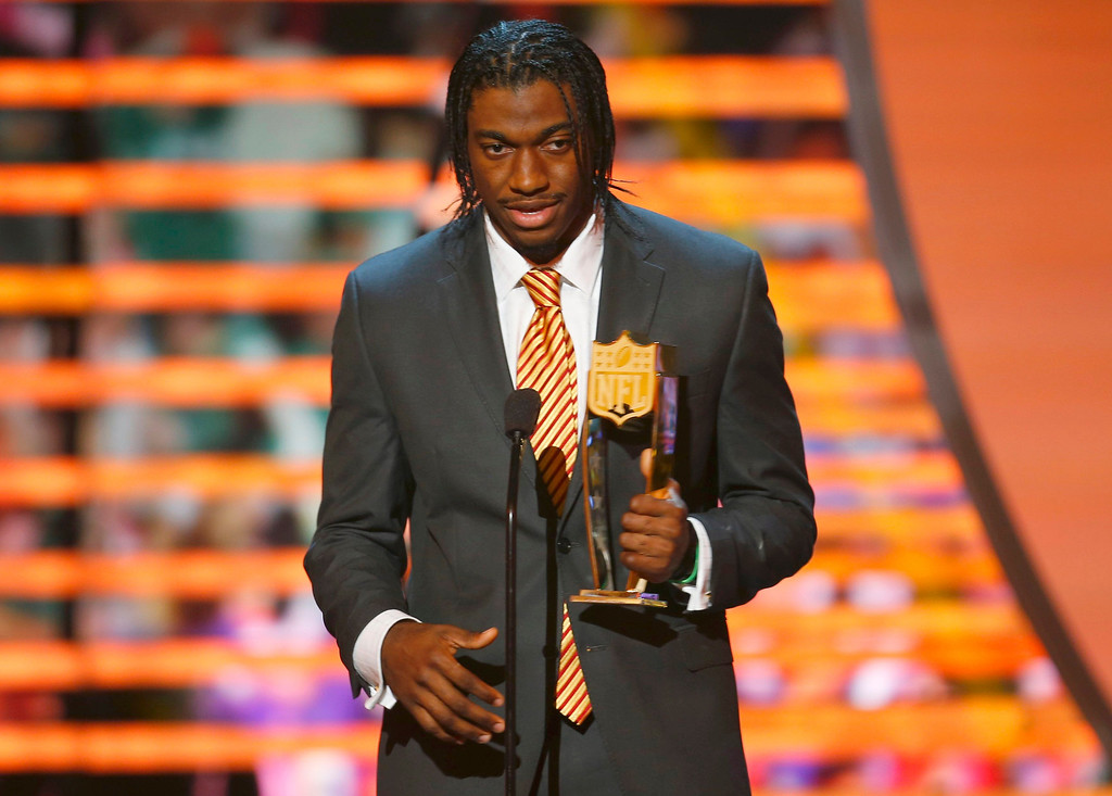 Description of . Washington Redskins quarterback Robert Griffin III accepts the the award for the NFL Offensive Rookie of the year during the NFL Honors award show in New Orleans, Louisiana February 2, 2013.   REUTERS/Jeff Haynes